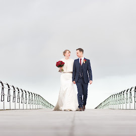 Hand in Hand... by Nigel Hepplewhite - Wedding Bride & Groom ( windy, wedding, christmas, ladnscape, pier, bride, groom )