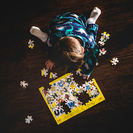 Puzzle Time by Mike DeMicco - Babies & Children Child Portraits ( puzzle, playing, sweet, play, above, children, kids, fun, cute, light, boy )