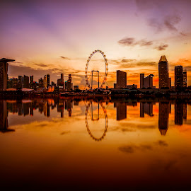 by Gordon Koh - City,  Street & Park  Skylines ( water, shenton way, skyline, reflection, riverfront, suntec city, marina bay sands, cityscape, dusk, singapore, urban, skyscraper, sunset, asia, cloud, singapore flyer, waterfront, ferris wheel )