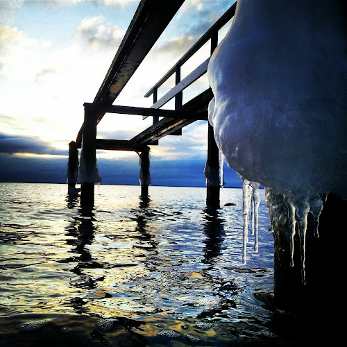 One icy formation  by Julija Moroza Broberg - Backgrounds Nature ( water, clouds, winter, sunset, ice, pier, sea )