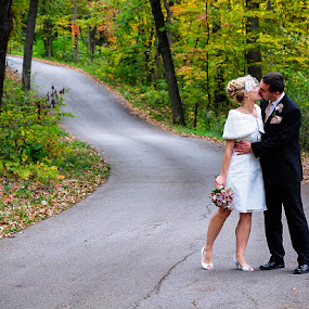 Bride and Groom Kissing in Wooded Scene by Sandra Rust - Wedding Bride & Groom ( bride and groom kissing in wooded scene )