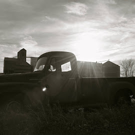 An Abandoned Silhouette by Taylor Gillen - Transportation Automobiles ( car, old, black and white, prairie, rural land )