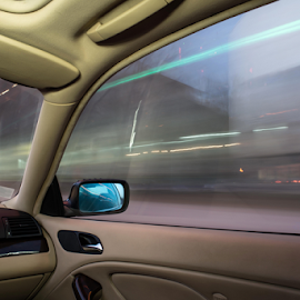 Car interior on driving. by Deyan Georgiev - Transportation Automobiles ( panel, car, drivers, interior, highway, wheel, bright, automobile, driveway, vehicle, driving, way, blur, travel, road, transportation, hand, sky, transport, hands, cars, drive, velocity, driver, trip, motion, light, piloting, control, asphalt, speed, journey, motorway, odometer, front, speedometer, blurred, traffic, safety, blue, inside, steering, active, auto, view, fast, dashboard )