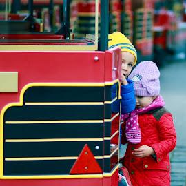 Children by the train  by Ingrid Velazquez - Babies & Children Children Candids ( red, cold, lovely, train, children, couple, happiness, kids, automn )