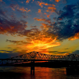 Nice Little Sunset  by Clifton Billingsley - Landscapes Cloud Formations ( water, sky, sunset, yellow, bridge,  )