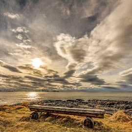 Bench under cloudes by Benny Høynes - Landscapes Cloud Formations ( bench, cloudes, waves, sea, rocks )