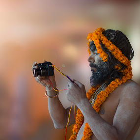 Everyone Loves Photography by Ravikanth Kurma - People Portraits of Men ( orange, naga, kasi, camera, varanasi, shivratri, maha, photographer, beard, bridge, flowers, sadhu, garland, man, taking photos, pwc75 )