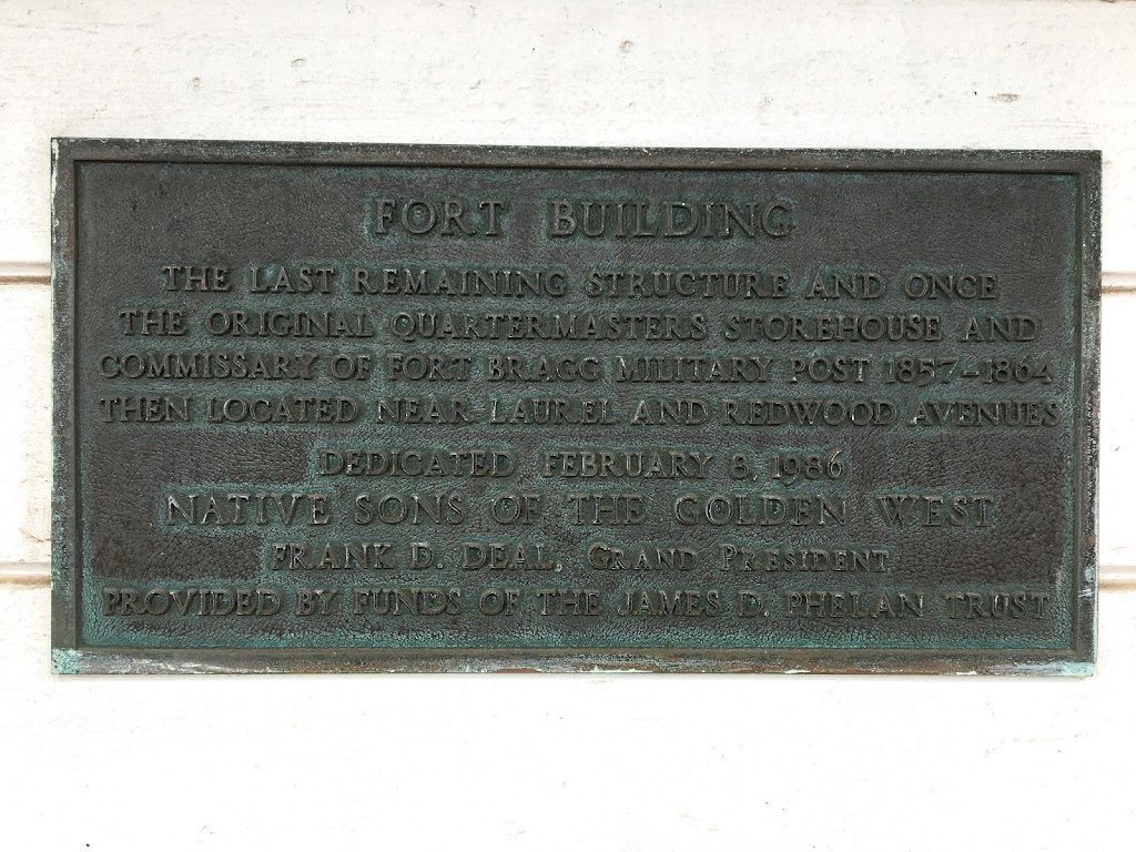 Plaque text:  Fort Building The last remaining structure and once the original quartermaster's storehouse and commissary of Fort Bragg military post 1857-1864, then located near Laurel and Redwood ...