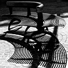 Shadows playing in the square  by Renata Apanaviciene - City,  Street & Park  Street Scenes ( bench, black and white, sunny day, desk, shadows )