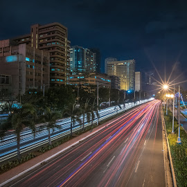 Trails and a Spark by Cynthia Pedrosa - City,  Street & Park  Night ( roxas boulevard, light trails, night, long exposure, manila, nightscape,  )