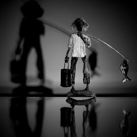 fisherman by Francisco Cardoso - Artistic Objects Still Life ( reflection, toy, black and white, shadow,  )