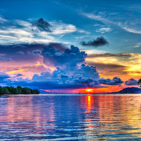 Sunset Over Calm Waters by Ryan Dominguez - Backgrounds Nature ( sunsets, lakes, cloudy skies, travel thailand, rain coming )