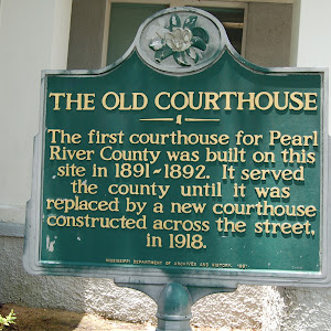 The first courthouse for Pearl River County was built on this site in 1891-1892. It served the county until it was replaced by a new courthouse constructed across the street, in 1918