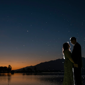 Evening Love Dust by Yansen Setiawan - Wedding Bride & Groom ( lovers, silhouette, sunset, wedding, lake, evening )