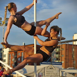 Pole dancing by Simo Järvinen - People Musicians & Entertainers ( pole dancing, girls, female, outdoor, entertainers, women, people, entertainment )