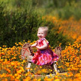 Rockababy by Liz Straight - Babies & Children Child Portraits ( canon, child, natural light, california, baby girl, child portrait, pink, sunlight, flowers )