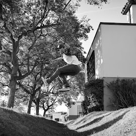 Jump by Tiffany O'Malley - People Street & Candids ( building, b&w, black and white, teen, shot, photo, hat, jump, vans, baseball cap, shoot, teenager, outdoor, action, high, nikon )