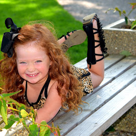 Smiles by Deborah Lucia - Babies & Children Child Portraits ( curly, red, bench, grass, hair, leopard, boots )