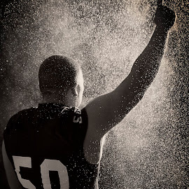 Champion by Deric Herbert - Sports & Fitness American and Canadian football ( champion, number 1, football, rain )