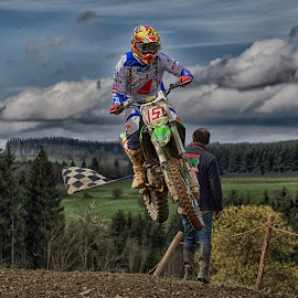 The Finish ! by Marco Bertamé - Sports & Fitness Motorsports ( clouds, speed, green, forest, number, yellow, race, noise, jump, finish, flying, red, flag, 151, motocross, blue, air, high )