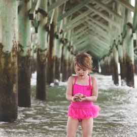 Under the Pier by Katie Shutter Bunny Meadows - Babies & Children Child Portraits ( child, little girl, girl, waves, seashell, pier, ocean, beach, kid,  )