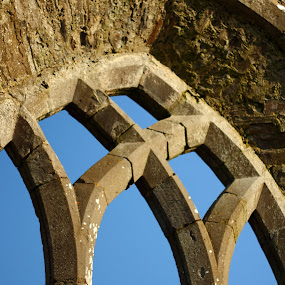 auld window by Michael Croghan - Buildings & Architecture Other Exteriors ( old, sky, blue sky, window, stone, shape, positive, pleasing, historic )