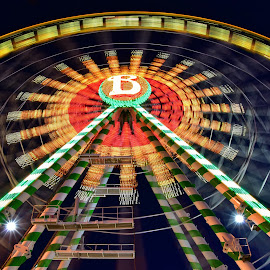 Fun Time ! by Marco Bertamé - City,  Street & Park  Amusement Parks ( orange, red, ferrrys wheel, schueberfouer, green, trail, yellow, painting, light )