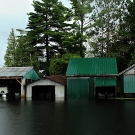 Lake Residence by Danielle Boulger - Buildings & Architecture Other Exteriors ( lightning, rain, green, lightning storm, boat launch, thunder, boats, clouds, rainstorm, water, boat, cloudy, canada, outdoors, ontario, outside, buildings, dark, vacation, river, travel, lake, architecture )