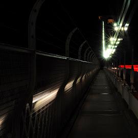 Clifton Suspension Bridge Walkway by DJ Cockburn - Buildings & Architecture Bridges & Suspended Structures ( civil engineering, river avon, cable, clifton down, architecture, road, clifton, motion blur, lights, fence, england, somerset, avon gorge, b3129, clifton suspension bridge, victorian, night, bristol, sidewalk, pavement )