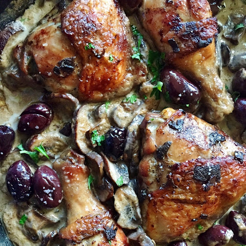 Marinated Roasted Chicken in a Wine Cream Mushroom Sauce Topped with Kalamata Olives.