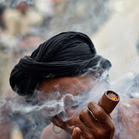 Smoke your pipe and be silent; there's only wind and smoke in the world.! by Yuni  Khan - People Portraits of Men ( mela, lahore, yuni photography, mela chiraghan, karachi, hussain shah, sufism, madhoo lal, younus hussain khan, devotee, mallags, Travel, People, Lifestyle, Culture,  )