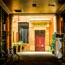 Old Walkway in Manchester, UK.  by T Sco - City,  Street & Park  Street Scenes ( bricks, door, city, chair, walkway, run, drive, manchester, walk, bike )