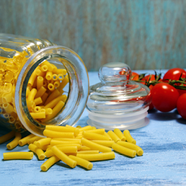 by Dipali S - Food & Drink Ingredients ( raw, uncooked, italian, cuisine, diet, tomato, carbohydrate, tube, yellow, ziti, penne, fresh, jar, glass, dry, texture, noodle, traditional, pasta, rigatoni, cherry, nutrition, tasty, wooden, pattern, blue, food, background, healthy, macaroni )