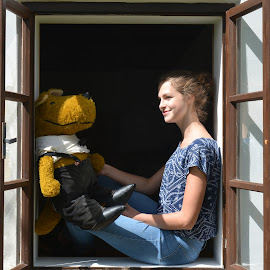 She and her friend. by Marcel Cintalan - People Street & Candids ( friends, toy, window, czech republic, summer, sunny day, young girl )