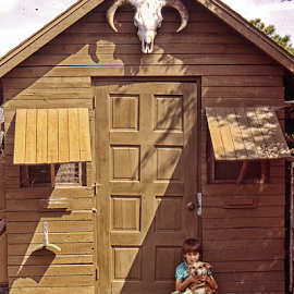 A boy with his dog by Joe Saladino - Babies & Children Child Portraits ( outbuilding, chicken house, skull, boy, dog )