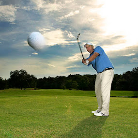 Fore by Josh Balduf - News & Events World Events ( clouds, ball, green, golfing, golfer, sky, lighting, sunset, club, trees, golf, glove, swing )