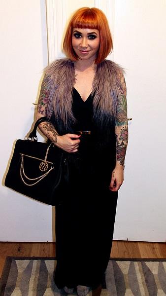 model wears black jumpsuit