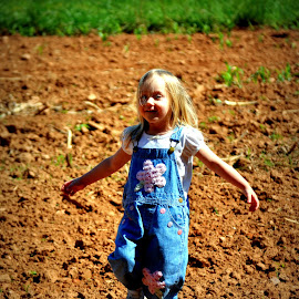 Spinning by Tammy Price - Babies & Children Children Candids ( child, field, helping, dirt, toddler, outside )
