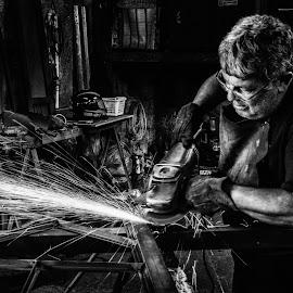 Blacksmith by Loris Calzolari - Black & White Portraits & People ( blacksmith, b&w, black and white, sparks, professional people )