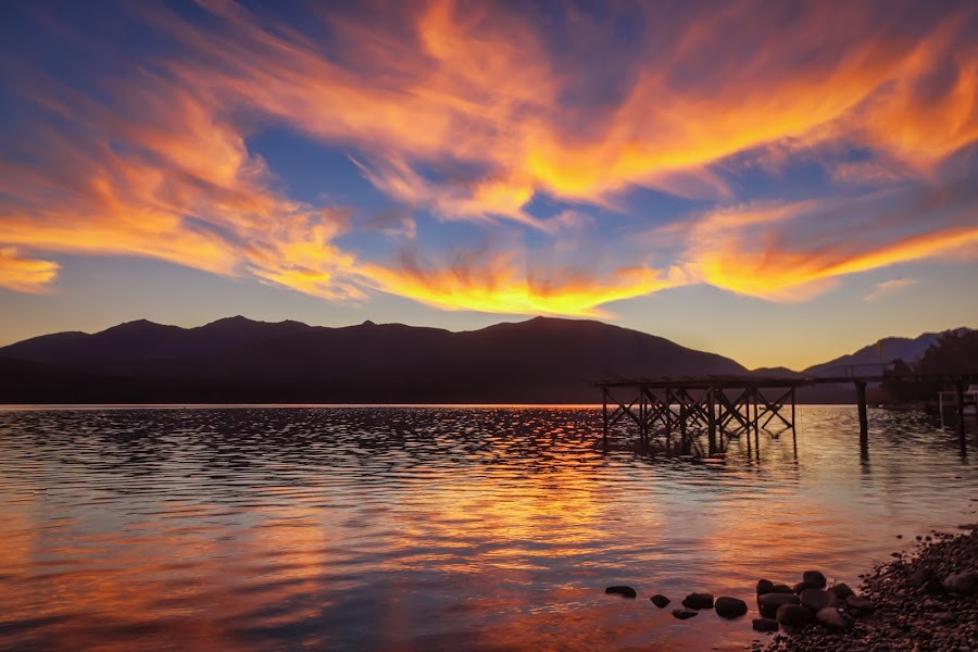 Fiery Sunset by Keith Walmsley - Landscapes Sunsets & Sunrises ( water, clouds, hill, reflection, sunset, landscape, new zealand, coast )