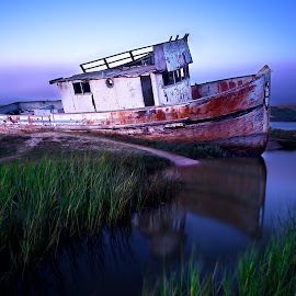 Reflecting on Troubles Past by Christian Wicklein - Transportation Boats ( water, color, shipwreck, sunset, ship, long exposure, rust, boat, decay, growth,  )