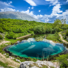 The Eye of Cetina by Mladen Bozickovic - Landscapes Travel ( water, clouds, mountain, croatia, lake, rock, forest, landscape, sky, cetina, nature, dinara, flowers, wellspring, deep, river )