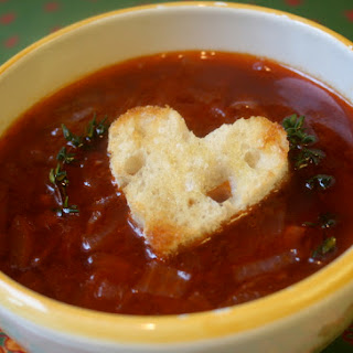 Red Onion And Red Wine Soup With Tomatoes, Thyme, And Heart Shaped Croutons