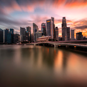 Glorious Skyline Over Shenton Way by Gordon Koh - City,  Street & Park  Skylines ( clouds, shenton way, reflection, cbd, skyline, skyscraper, sunset, vista, asia, long exposure, waterfront, jubilee bridge, singapore )