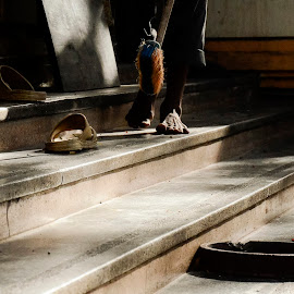 Cleaning a temple. by Cassandra G - People Street & Candids