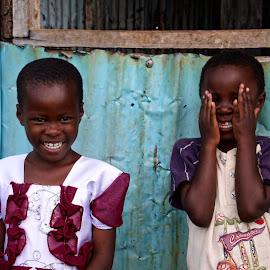 Peekaboo  by Cyndi Rosenthal - Babies & Children Children Candids ( metal, poverty, blue, peekaboo children girl boy africa, children, peekaboo, smiles, culture )