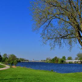 Lets Take A Walk by Howard Sharper - City,  Street & Park  City Parks ( springtime, park scene, cityscape, pathway, riverside,  )