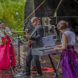 Artists surprise rain ... by Sakari Partio - People Musicians & Entertainers