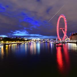 Red eye, blue sky. by Paul Coomber - City,  Street & Park  Skylines ( london eye, london, reflections., long exposure, night shot, river )