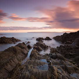 Rocky seascape by Alek Kisielewicz - Landscapes Sunsets & Sunrises ( clouds, ireland, sunset, sea, long exposure, rocks )